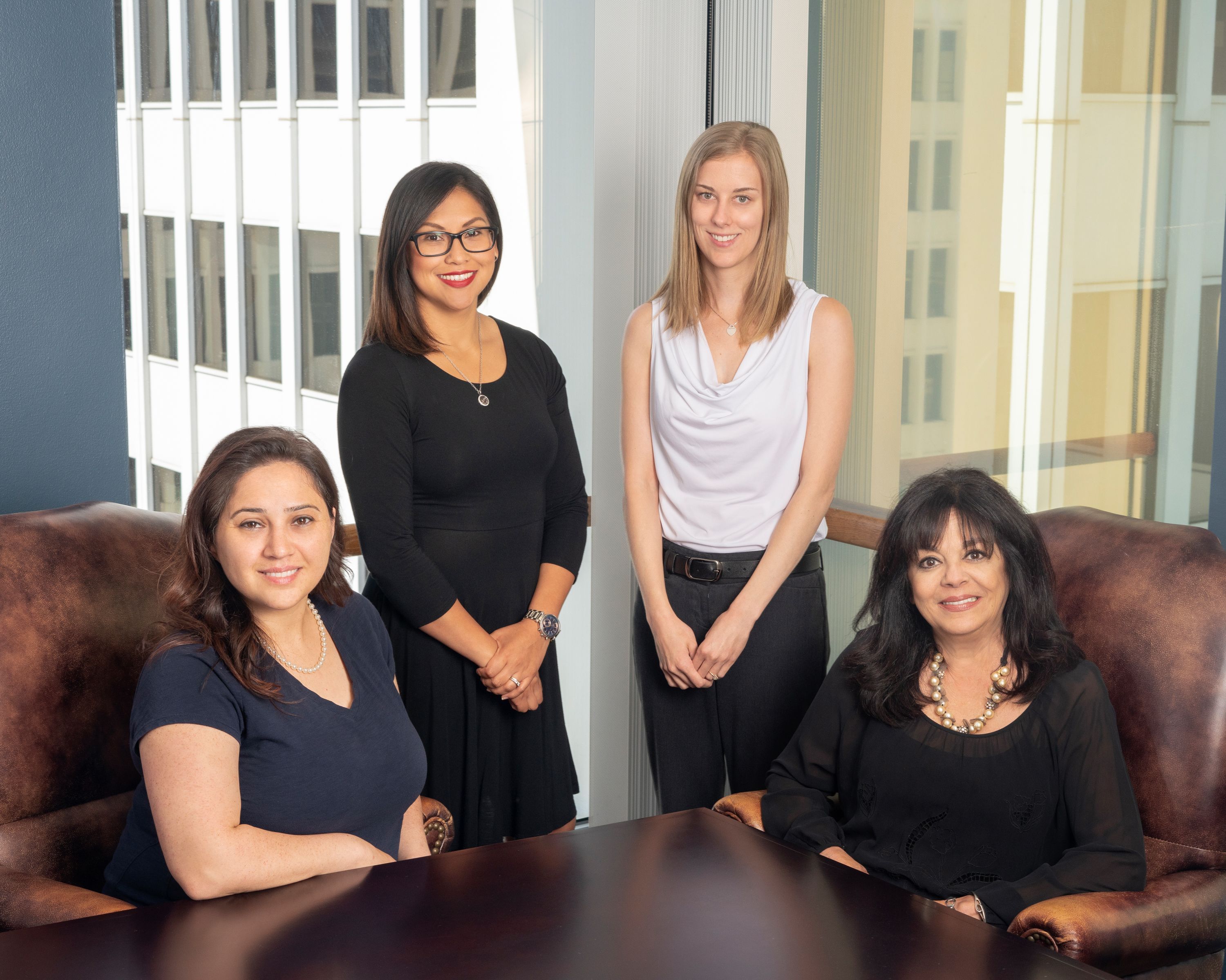 Group photo of four paralegals